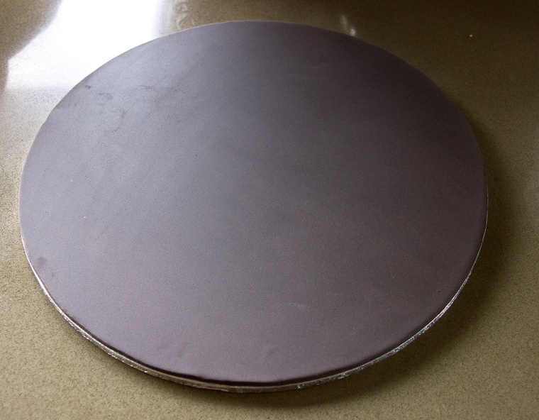 Cake board covered with black sugar-paste
