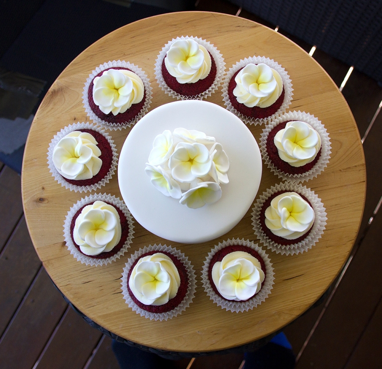 Red Velvet cupcakes decorated with Sugar Frangipanis